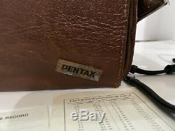 Pentax K1000 Vintage Camera With Original Leather Case Extra Lens And Flash