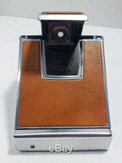 Polaroid Sx-70 Land Camera With Original Divided Leather Case Bulbs And Manual