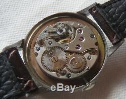 Rolex military wristwatch steel case load manual original dial 31 mm in diameter