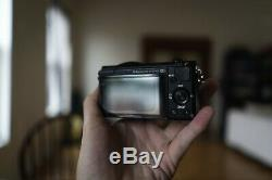 Sony a5100 camera With 16-50mm kit lens. Original box. Leather case/strap. 64GB SD